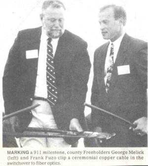 Freeholders Melick and Fuzo at the ceremony to switch over to fiber optic cables at the Office of Communications, on June 23, 1992